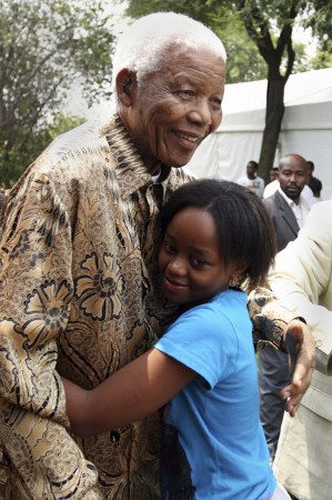 Handout picture of former South African President Nelson Mandela hugging his great granddaughter Zenani Mandela in Diepkloof, Soweto