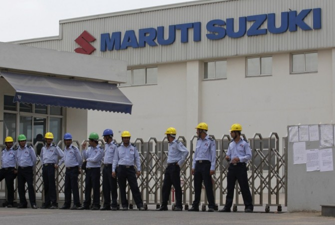Private security guards stand outside the main entrance to the Maruti Suzuki India Limited plant where workers are striking in Manesar.