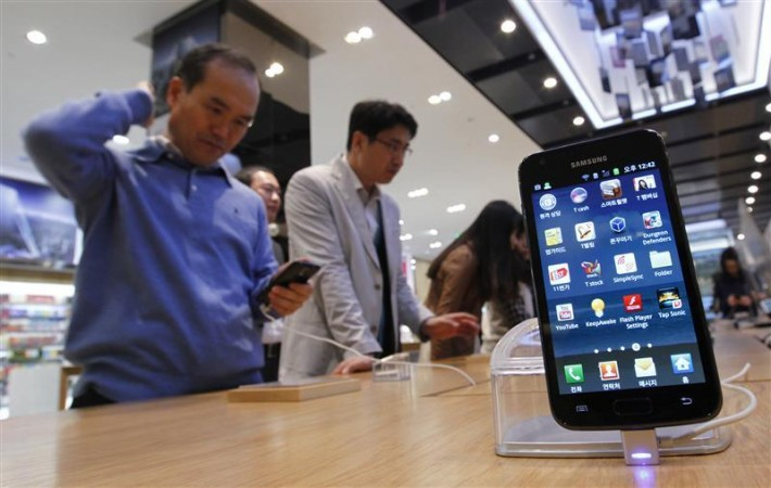 Customers look at Samsung Electronics' Galaxy series smartphones on display at a shop in Seoul