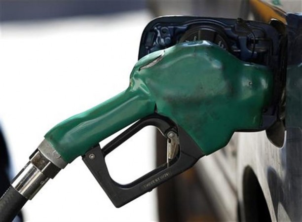 A gas nozzle is used to pump petrol at a station