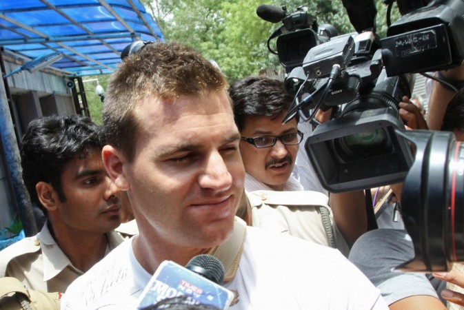 Australian cricketer Luke Pomersbach (C), surrounded by media, leaves the hospital on his way to a local court for a hearing in New Delhi May 18, 2012. Pomersbach has been arrested on molestation and assault charges, a senior Delhi Police official said on Friday. The 27-year-old was alleged to have molested a woman and physically attacked her male friend in a city hotel during a party after Pomersbach's Bangalore team had beaten Delhi in an Indian Premier League (IPL) match on Thursday.