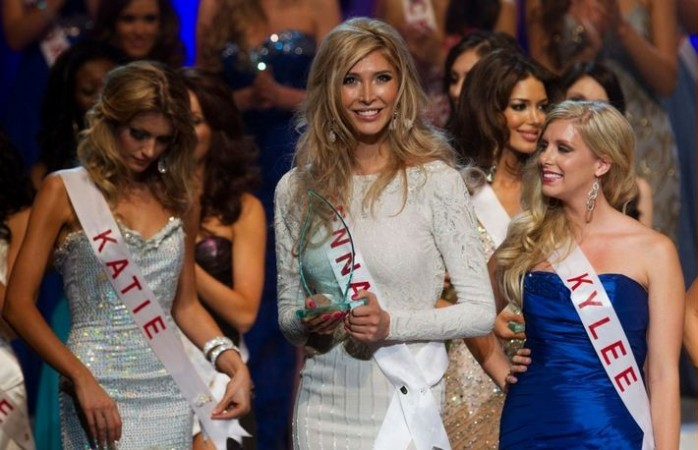 Transgender contestant Jenna Talackova (C) holds the award for Miss Congeniality at the end of the Miss Universe Canada competition in Toronto, May 19, 2012.