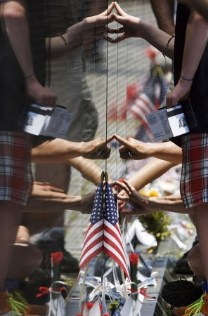 People touch the Vietnam Veterans Memorial wall