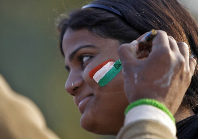 A Woman gets her face painted in tri-colours of India's national flag near the India Gate during the Republic Day celebrations in New Delhi (Reuters)