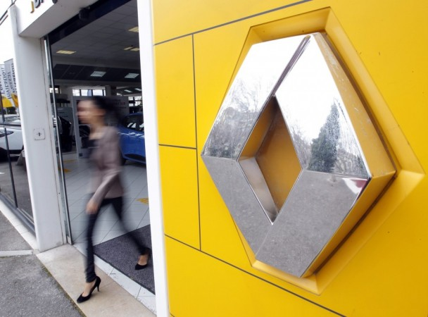 A woman leaves a Renault automobile dealership in Marseille.