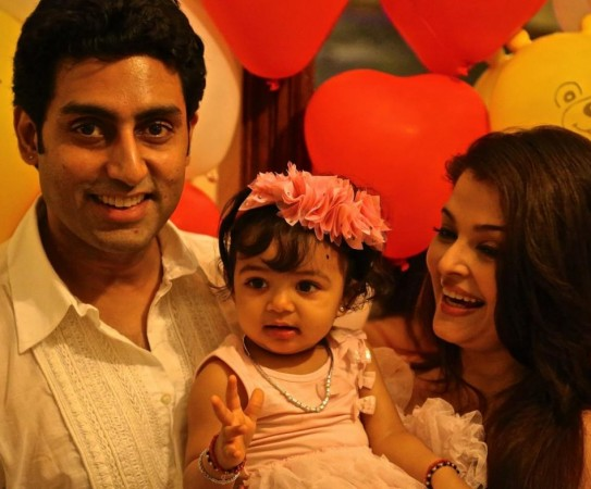 Aaradhya With her parents on her 1st birthday 16 Nov 2012