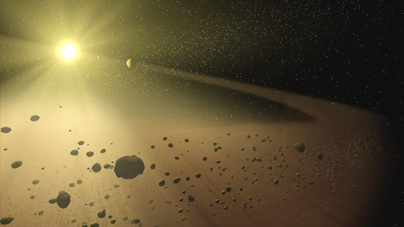 In this artist's concept, a narrow asteroid belt filled with rocks and dusty debris orbits a star similar to our own sun