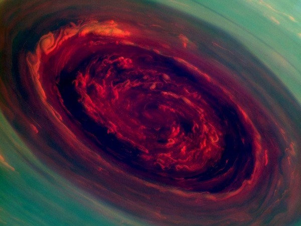 The spinning vortex of Saturn's north polar storm resembles a deep red rose of giant proportions surrounded by green foliage in this false-color image from NASA's Cassini spacecraft. (Credit: NASA/JPL-Caltech/SSI)