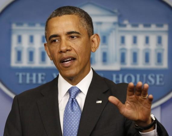U.S. President Barack Obama gestures while talking