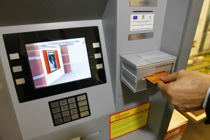 Malaysian Robbers Drag out and Carry Away ATM (Credit: Reuters)