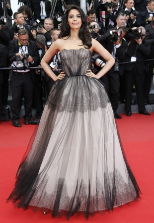 """Bollywood actress Mallika Sherawat poses on the red carpet as she arrives for the screening of the film """"Inside Llewyn Davis"""" in competition during the 66th Cannes Film Festival in Cannes May 19, 2013."""