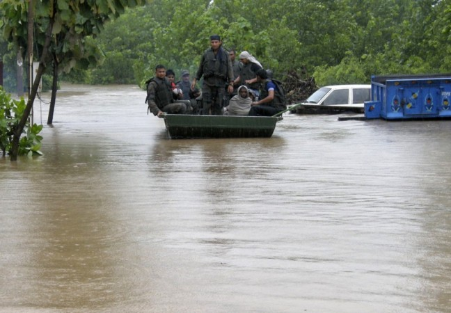 Indian army soldiers rescue stranded villagers in a boat after floods triggered by heavy rains(Reuters)