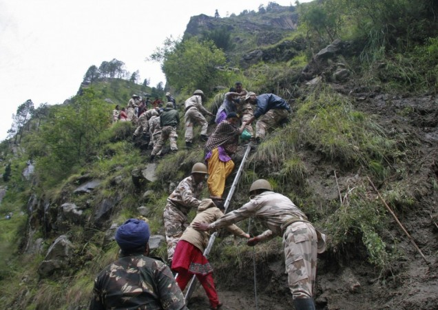 Soldiers rescue stranded people after heavy rains in the Himalayan state of Uttarakhand(Reuters)