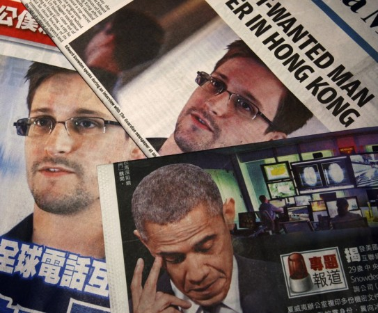 Photos of Edward Snowden, a contractor at the National Security Agency (NSA), and U.S. President Barack Obama are printed on the front pages of local English and Chinese newspapers in Hong Kong