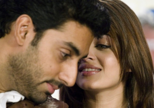 Bollywood actors Abhishek Bachchan and Aishwarya Rai Bachchan (R)