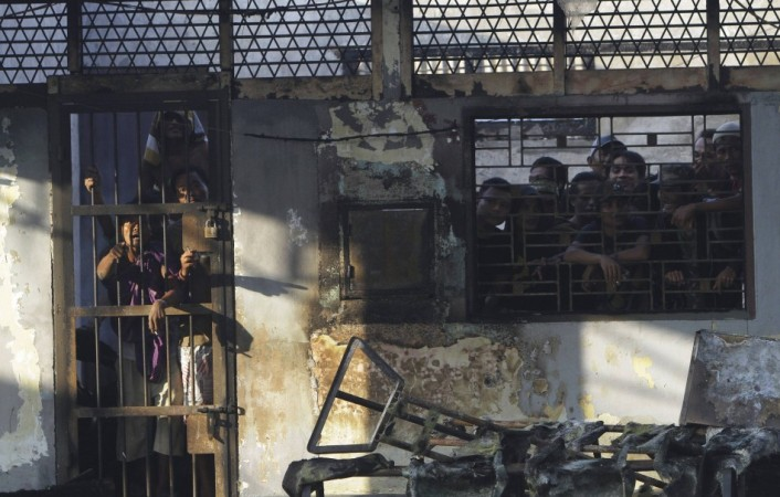 Prisoners stand inside the burned Tanjung Gusta prison, which was set ablaze by inmates after a riot broke out, in Medan in North Sumatra province(Reuters)