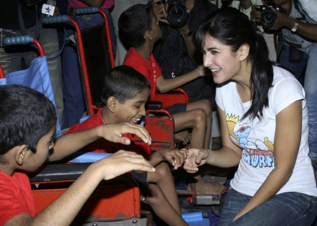 Kaif (R) speaks with disabled children who came for a special screening of her movie