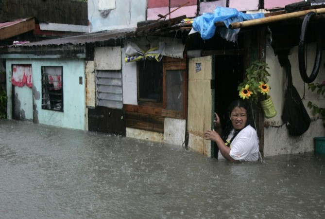 A woman wades in floodwaters. (representational image)