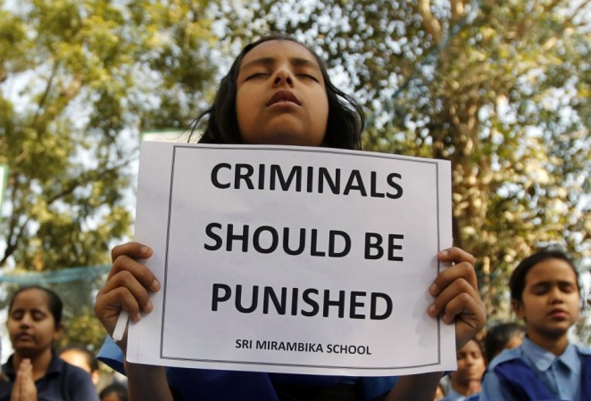 Schoolgirls pray to pay homage to a rape victim who was assaulted and gang raped in New Delhi on 16 December, 2012. The gang rape sparked protests and a national debate about violence against women in India. The four accused were found guilty of the crime