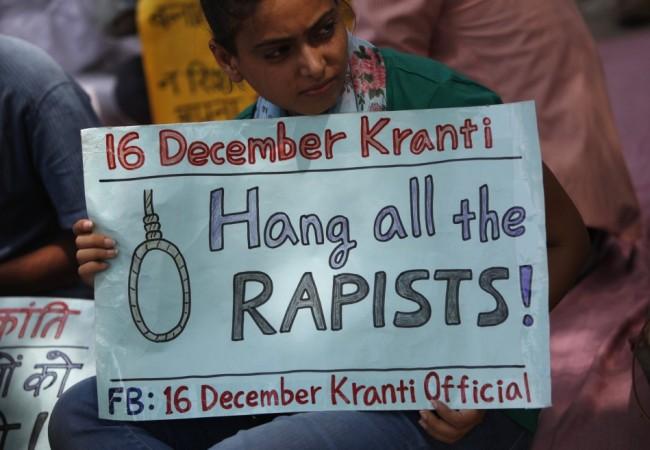 A demonstrator protest in New Delhi September 1, 2013.