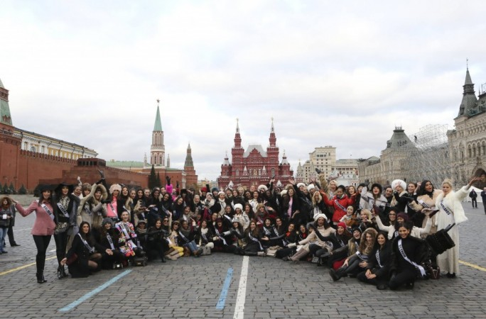 Contestants in the forthcoming Miss Universe pose for photographers during a photo opportunity in Moscow's Red Square