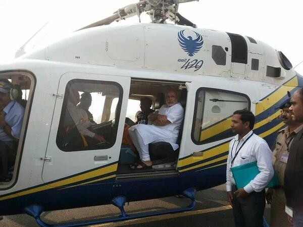 Gujarat CM Narendra Modi in a chopper while on his way to meet victims of Patna serial bomb blasts