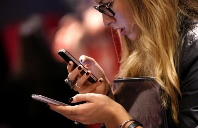 A consumer checks out smartphones (Reuters)