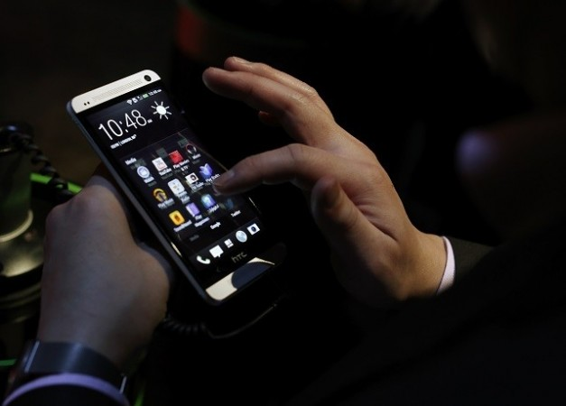 An Attendee Tests the New HTC One During a Launch Event in New York