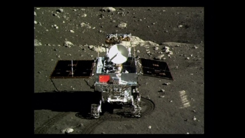 A view of China's first moon rover, Yutu, or Jade Rabbit, is seen on the lunar surface with the Chinese national flag in this still image taken from video provided by China Central Television (CCTV) December 16, 2013. China landed an unmanned spacecraft o