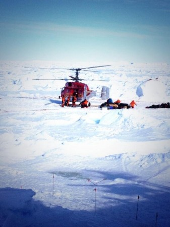The Chinese helicopter taking the stranded scientists and crew members