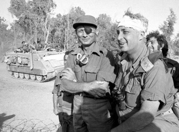 Moshe Dayan with an injured Sharon, then a major general in the reserves, on the western side of the Suez Canal in October 1973. The photo of the famed general with a bandaged head became an iconic image in his country./File Photo:Israel Defence Ministry/Reuters