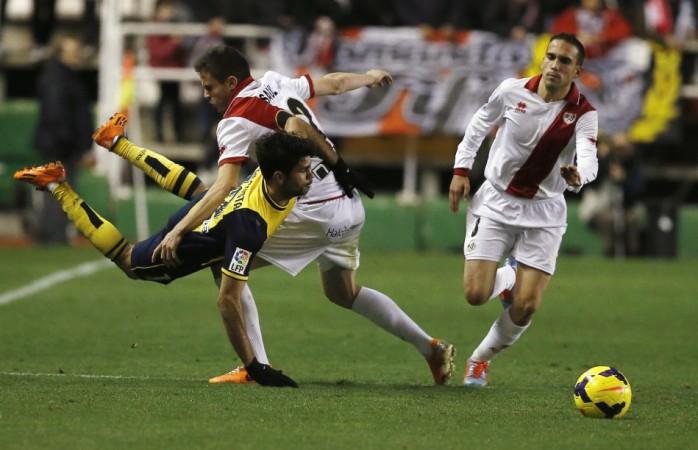 Saul Niguez brings down Diego Costa