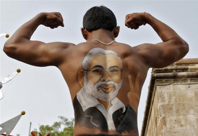 Narendra Modi Painted in a supporter's back (Reuters)