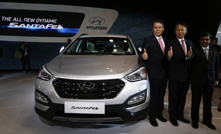 Senior executives of Hyundai Motors India Limited (HMIL) pose with Hyundai's Santa Fe car during its launch at the Auto Expo in Greater Noida on the outskirts of New Delhi on February 5, 2014.