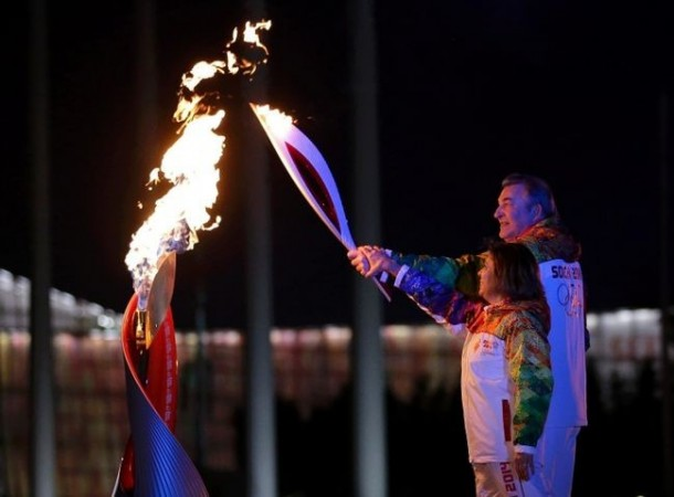 Former hockey player Vladislav Tretiak (back) and figure skater Irina Rodnina light the Olympic cauldron during the opening ceremony of the 2014 Sochi Winter Olympics, Feb. 7, 2014. (MATT SLOCUM/Reuters)