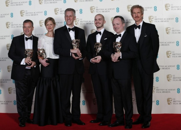 """Gravity"" special visual effect team celebrates winning the category for Special Visual Effects with the film with actor Modine at the BAFTA awards ceremony in London"