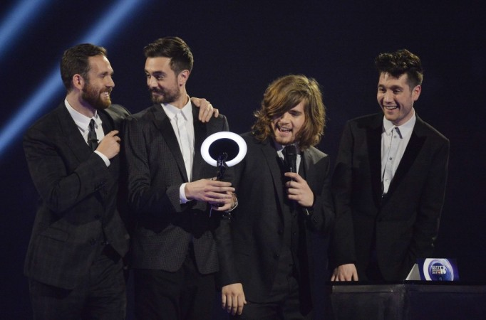 Members of Bastille react after being presented with the British Breakthrough Act award at the BRIT Awards in London