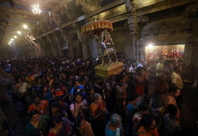 Hindu devotees pray while carrying a statue of Lord Shiva during the annual Maha Shivaratri festival at Shivam Kovil in Colombo February 27, 2014