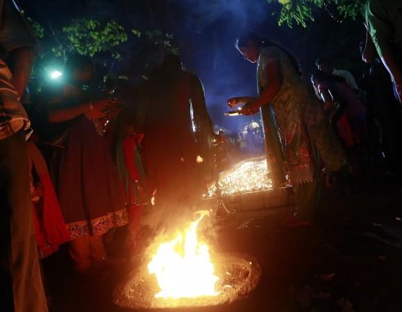 A Hindu devotee lights an oil lamp during the annual Maha Shivaratri festival at Shivam Kovil in Colombo February 27, 2014.