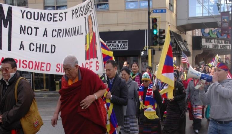 Tibetans rally across Minneapolis downtown to mark the 55th Tibetan national uprising anniversary in Minnesota, U.S.A (Photo Credit: Tendar Tsering)