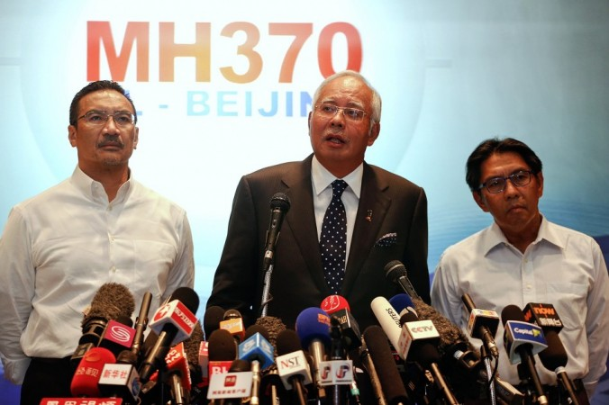 Malaysian PM Najib addresses reporters about the missing Malaysia Airlines flight MH370 at Kuala Lumpur International Airport