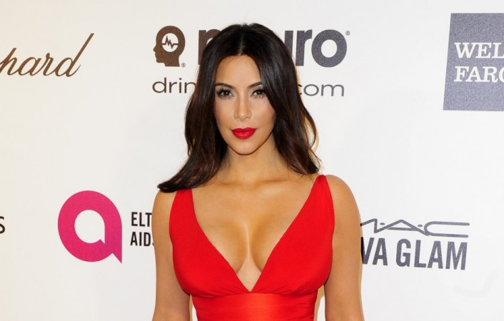 Kim Kardashian arrives at the 2014 Elton John AIDS Foundation Oscar Party in West Hollywood