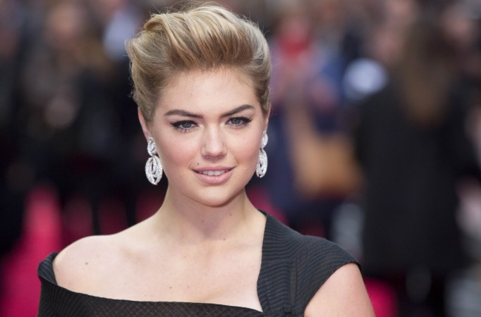 Actress and model Kate Upton poses for photographers as she arrives for the UK Gala screening of The Other Woman in London