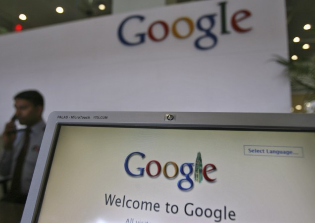 A Security Personnel Answers a Call at the Reception Counter of the Google Office in the Southern Indian City of Hyderabad