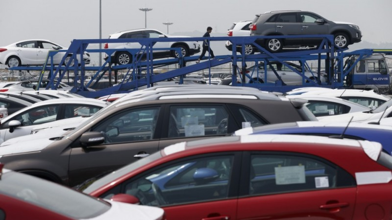 File photo of cars made by South Korea's Hyundai Motor Group on a truck at the company's shipping yard at a port in Pyeongtaek