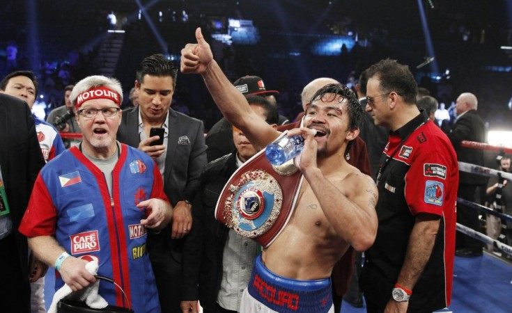 Pacquiao of the Philippines Celebrates His Victory Over Bradley of the U.S. After Their Title Fight at the MGM Grand Garden Arena in Las Vegas