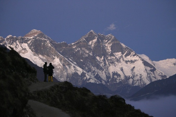 Travellers enjoy a view of Mount Everest at Syangboche in Nepal, in this December 3, 2009 file photograph. REUTERS/Gopal Chitrakar/Files