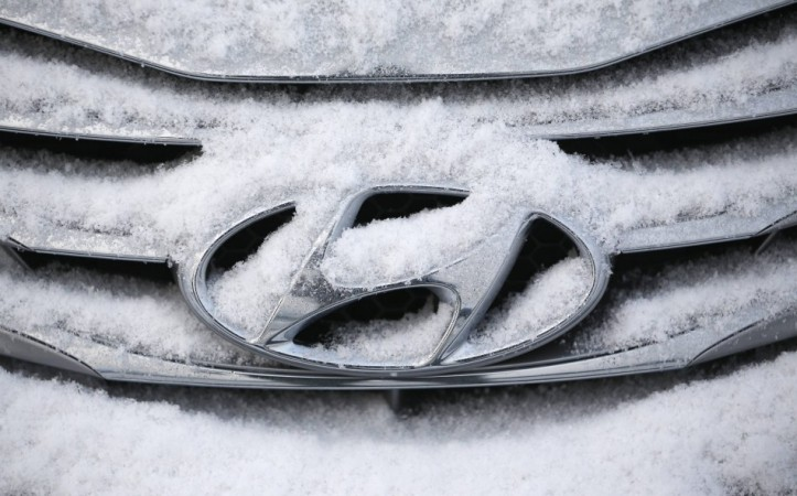 File photo of a logo of Hyundai Motor on a sedan covered with snow at a shipping yard in Pyeongtaek