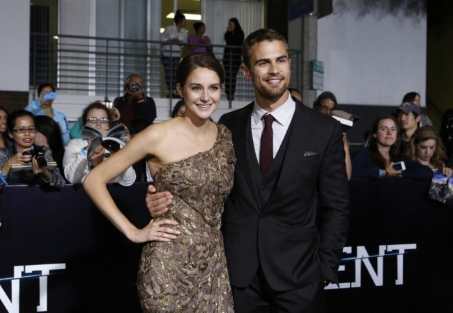 """Cast members Shailene Woodley and Theo James pose at the premiere of """"Divergent"""" in Los Angeles"""