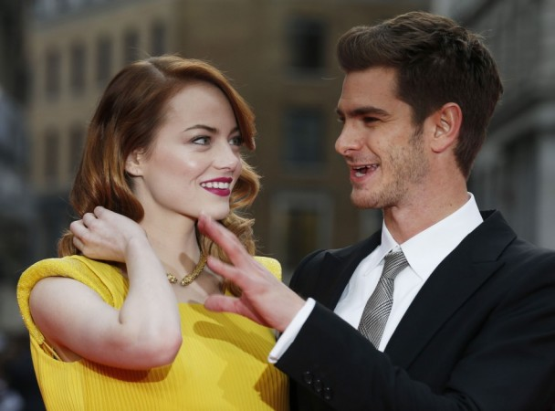 Actors Emma Stone and Andrew Garfield pose for photographs at the world premiere of The Amazing Spiderman 2 in central London, April 10, 2014. REUTERS/Olivia Harris